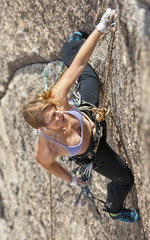 Climber gripping the rock.