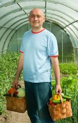 Gardener   with vegetables harvest