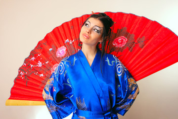 girl in blue asian bathrobe with dragons