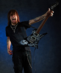 Brutal man with electric guitar