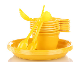 Bright yellow plastic tableware isolated on white