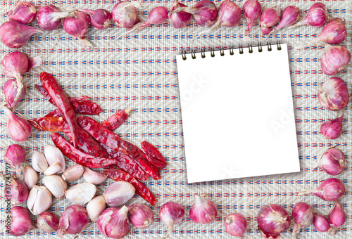 frame of spicy ingredients - onion chilli garlic