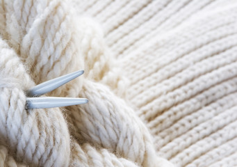 knitting background - needles and yarn