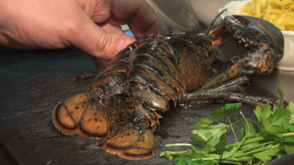 exhibition of live lobster with cooking element