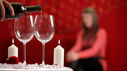 Man pours the wine in wineglasses. HD