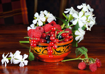 Still life with various berry and white flowers