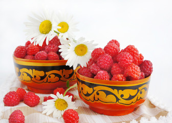 Still-life with a raspberry and camomiles