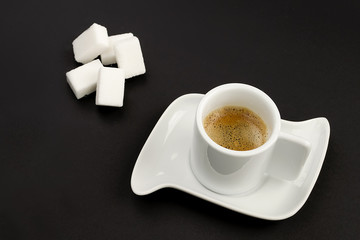 coffee and sugar on black