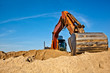 Excavator during earth moving works outdoors at sand quarry