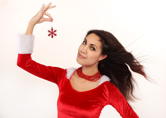 Attractive adult Santa girl with snowflake