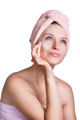 Beautiful woman applying cream