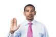 Hispanic man taking oath or pledge hand raised