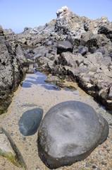 Roca en agua de mar
