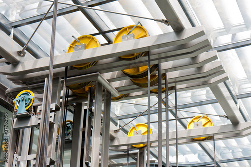 canvas print picture Holding frame of an open steel lift shaft in a modern bulding