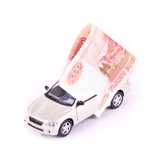 Model cars and banknotes isolated