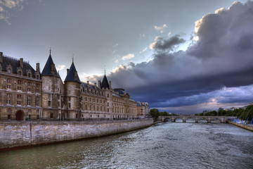 Conciergerie before rain in Paris, dramatic cloudscape.