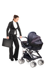 A young businesswoman pushing a baby stroller