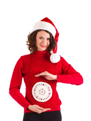 Beautiful pregnant girl in Santa Claus clothes