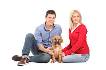 Couple with a cane corso puppy