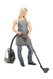 Female cleaning with vacuum cleaner