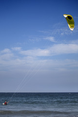 A man setting up to do a bit of kitesurf