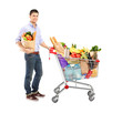 Man holding a shopping bag and shopping cart