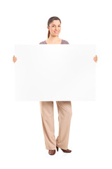 Happy woman holding a blank billboard