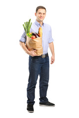 Full length portrait of a man holding a shopping bag