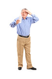 Full length portrait of a surprised senior looking at store rece