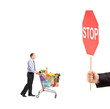 Man pushing a shopping cart full with food and a hand holding a