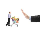 Man pushing a shopping cart full food ingredients and a hand ges