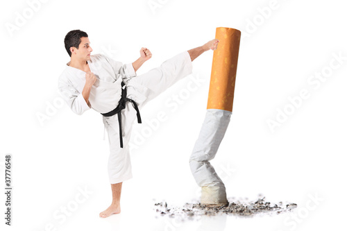 Karate man hitting a cigarette butt