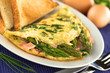 Green asparagus and ham omelet with toast bread