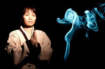 Woman and blue incense smoke.