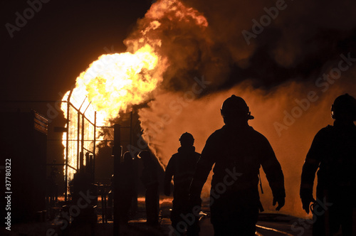 firefighters in action after a gas explosion - 37780322