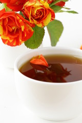 Tea cup  with rose petals