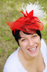 Portrait of happy young bride with red veil