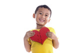 Cute asian boy holds a heart