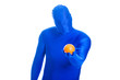 Faceless, anonymous blue man holding a fresh orange.
