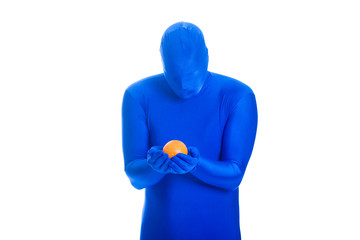 Faceless man in blue body suit staring at an orange