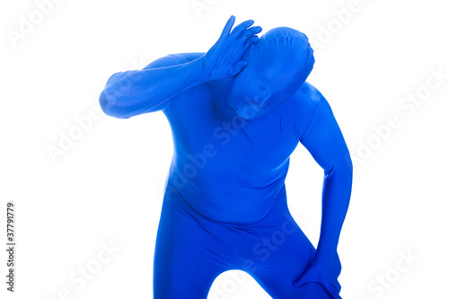 faceless anonymous man in blue body suit hard of hearing