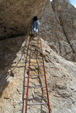 via ferrata - woman on iron ladder