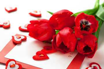 Red tulips and greeting card