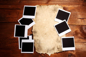 Photo papers with old paper on wooden background
