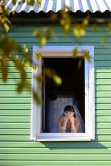 The bride look at window