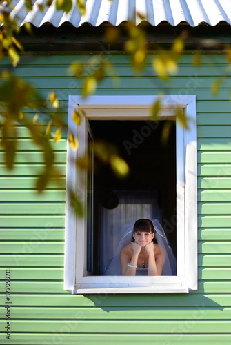 The bride look at window