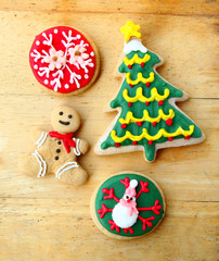 Decorated christmas gingerbreads on wooden background