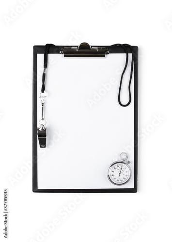 Leinwandbild Motiv Blank clipboard with whistle and stopwatch