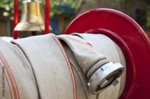 Detail of fire hose with alarm bell