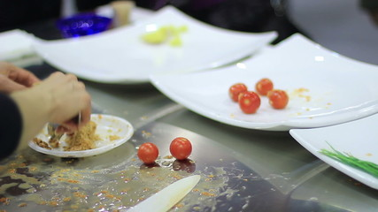 Chef cooking an appetizer of stuffed tomatoes
